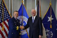 Rear Adm. Paul Thomas shakes hands with Captain Blaine Collins, DNV GL vice president of group governmental and public affairs for the U.S., following the signing of the new memorandum of agreement. The MOA authorizes DNV GL to participate in the Alternate Compliance Program. (Photo: U.S. Coast Guard)