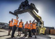 Williams Shipping's cargo handling team with their new reach stacker in new one-acre yard at the firm's Millbrook headquarters in Southampton. (Photo: Williams Shipping)