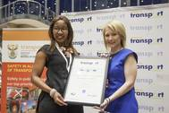 Sylvia Siyo, Acting Ship Repair Manager in the Port of Durban (left), receiving the Best Head of Department in Transport award from Catherine Larkin, Executive Director of the Chartered Institute of Logistics and Transport. Photo TNPA