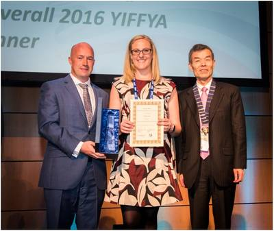 FIATA Young Forwarder of the Year Winner, Shanon Gould receives her award from, on the left TT Club's Senior Loss Prevention Executive, Mike Yarwood and Huxiang Zhao, President of FIATA (Photo: TT Club)
