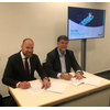 Ronald Spithout, President, Inmarsat Maritime and Hans Ottosen, CEO, Danelec Marine signing the Fleet Data agreement (Photo: Inmarsat)