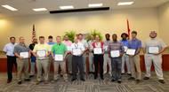 Austal USA honored 15 graduates of Austal's cutting-edge four-year apprenticeship program.