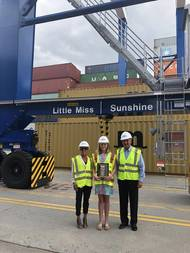 "SCPA COO Barbara Melvin (from left), fifth grader Haven Ebel and SCPA CEO Jim Newsome stand beside the rubber-tired gantry crane Ebel named ""Little Miss Sunshine"" at Inland Port Greer."