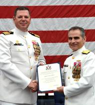 Rear Adm. Brian Brown, commander, Naval Meteorology and Oceanography Command, (right) presents  Capt. Van Gurley with a certificate of retirement commemorating 26 years of naval service during a ceremony held July 12 at Stennis Space Center, Miss.  (U.S. Navy photo by Jenni Ervin)