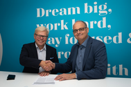CADMATIC CEO Jukka Rantala (left) and Kymdata CEO Jyrki Metsola (right) shake hands on the acquisition agreement.  (Photo: Cadmatic)