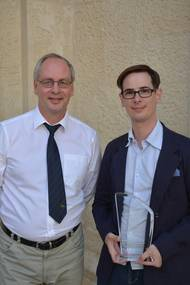 COMPIT organizer Volker Bertram from DNV GL (left) presented Henrique M. Gaspar (right) with the DNV GL COMPIT Award 2016. (Photo: DNV GL)