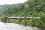 A crude oil train segment rumbles alongside a U.S. inland waterway. CREDIT: Dagmar Etkin