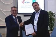 David Barrow, LR Commercial Director – Marine & Offshore presents the AiP to Maarten Spilker, Wison Solutions Director at Gastech this week in Barcelona. (Photo: Lloyd's Register)
