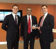 David Phillips (middle), Chairman of the NAFL and CEO of Freight Systems LLC presents Julien Horn (left) and Andrew Kemp (right) from TT Club with an award in recognition of their expertise.