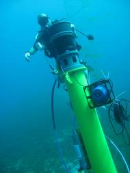 A diver completes the installation of Sentinel sonar heads and Scylla underwater loudhailers.