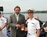 Ensign Jeffrey Iiams receives the Elmer A. Sperry Junior Navigator of the Year Award from Jeff Holloway of Northrop Grumman Corporation.