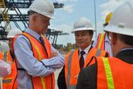 Port Everglades Chief Executive Steven Cernak and ZPMC Chairman Zhu Lianyu discuss the progress of improvements to the crane rail infrastructure that is already underway on the Southport docks. Photo Credit: Broward County's Port Everglades