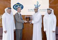 "Amer Ali, Executive Director of DMCA, and his team receiving Mr. Simon Duran, the Director General of ""GAC EnvironHull Limited"" at the DMCA HQ in Dubai. (photo: DMCA)"