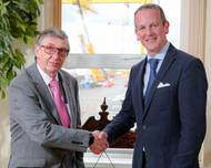 Harland and Wolff's retiring CEO Robert J Cooper shakes hands with his successor Jonathan Guest (Photo: Harland and Wolff)