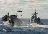 File Image: U.S. Navy warships underway and engaged in underway replenishment. CREDIT: U.S. Navy