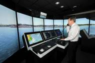 Capt. John Kessler, maritime instructor, demonstrates how mariners train using the bridge simulators at the San Jacinto College maritime program. Photo credit: Jeannie Peng-Armao, San Jacinto College