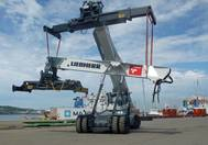 A Liebherr LRS 545 reachstacker assembling its six companions in Durban Port, South Africa. (Photo:   Liebherr )