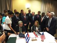 Manuel Fernandez Perez Guerra, Director General of the National Port Administration of Cuba, and Brandy Christian, Port of New Orleans Chief Operating Officer, sign a memorandum of understanding in Havana Oct. 4. Louisiana Gov. John Bel Edwards (standing directly behind Christian) and Michael Kearney, Chairman of the Port of New Orleans Board of Commissioners (standing front right), were among the 50-member Louisiana trade delegation that visited Cuba Oct. 3-7. Photo NOLA