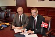 SUNY Maritime academic deal Gil Traub (left) and SIMAC vice president for academic affairs Jan Askholm sign the memorandum of agreement at SUNY Maritime College. The agreement paves the way for collaboration and partnership between the two institutions. (Photo: SUNY Maritime)