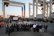 Officials from Konecranes and the Georgia Ports Authority commemorated the 1,000th rubber-tired gantry crane produced by the company, and completion of the latest phase of GPA's electric RTG infrastructure. The eRTGs use 95 percent less diesel than standard RTGs, saving on fuel costs and emissions.  (Photo: GPA)