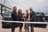 Photo Credit/Port NOLA: From left to right: Director of Marketing for XL Fleet Eric Foellmer, Port NOLA President & CEO Brandy D. Christian, Executive Director of Regional Planning Commission Jeffrey Roesel and Director of Southeast Louisiana Clean Fuel Partnership Courtney Young cut the ribbon on two new plug-in hybrid trucks.