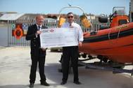 Eric Plance presents donation to RNLI (Credit Fendercare)