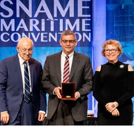 "HII President and CEO Mike Petters, center, accepts the 2019 Vice Admiral Emory S. ""Jerry"" Land Medal from, at left, Fred Harris, former president of General Dynamics NASSCO and Bath Iron Works, and Suzanne Beckstoffer, president of Society of Naval Architect and Marine Engineers (SNAME). The Land Medal is presented to an individual for outstanding accomplishment in the marine field. Photo courtesy of SNAME"
