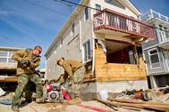 Pumping Out Residential Premises: Photo credit USN