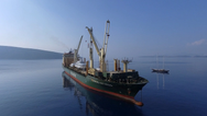 """""""RICKMERS ANTWERP is one of nine identical sister vessels employed in the Rickmers-Line Round-The-World Pearl String Service. She is here pictured loading yachts in Bodrum, Turkey."""" Photo: Rickmers-Line"""