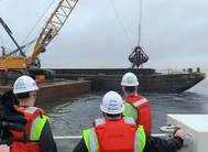 Left to right: MD Secretary of Transportation Gregory Slater, MD Governor Larry Hogan, and MPA-Port of Baltimore Executive Director William Doyle observe dredging operations at Seagirt Marine Terminal for a new 50-ft. berth in March 2021. (Photo: Maryland Port Administration)