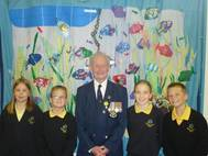 Royal Navy Veteran Roy Ticehurst with pupils from Woodmansterne Primary School Helen Marshall, James Stephenson, Azura Stones and Dylan Brown, all aged 11