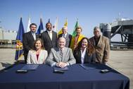 """(Seated, from left) Kim Ostrowski, Director of the Navy Base Realignment and Closure Program Management Office West; Maritime Administrator Paul """"Chip"""" Jaenichen; Harbor Commissioner Tracy Egoscue; (standing, from left) Richard Cameron, Port Managing Director of Environmental Affairs and Planning; Long Beach Vice Mayor Rex Richardson; Port CEO Jon Slangerup; former Long Beach Mayor Beverly O'Neill; and Long Beach Councilmember Roberto Uranga, District 7.)"""