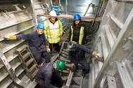 Stewart Graves, managing director, and Rita Beard, safety officer, observing work being carried out by Benjamin Cardew, Paul Hethrington and Richard Davey on the 20m BMT Nigel Gee design wind farm support vessel (Photo courtesy of Mustang Marine)