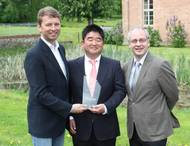 Dr Tatsuo Nishikawa (middle) is presented with the DNV GL Compit Award 2015 by Albrecht Grell (left), Director of the Maritime Advisory Division at DNV GL - Maritime, and COMPIT organiser Volker Bertram (right), DNV GL - Ma