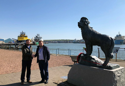 Agency Manager David Thorburn (left) with the Harbourmaster of Montrose Port Authority, Tom Hutchison and local legend Bamse the St Bernard. (Photo: GAC Group)