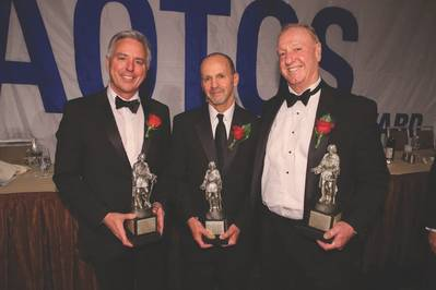 Matt Cox, Anthony Chiarello and Jim McKenna with their USS AOTOS statues.