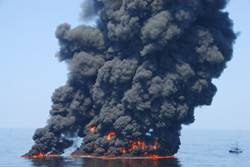 Black smoke billows from a controlled burn of surface oil during the 2010 Deepwater Horizon oil spill. A new study by NOAA and the Cooperative Institute for Research in Environmental Sciences (CIRES) found that controlled burns released more than one million pounds of sooty black carbon into the atmosphere.