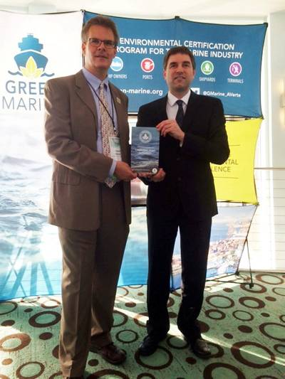 Port Canaveral Director of Environmental, Bob Musser (left) accepts the Green Marine Certification from David Bolduc, Green Marine Executive Director at the annual GreenTech conference held in Ft. Lauderdale, Fla. (Photo: Port Canaveral)