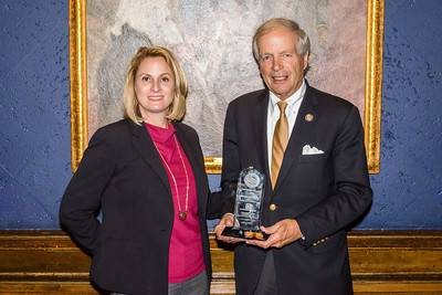 Port NOLA Chairman Michael Kearney, joined by Port NOLA President and CEO Brandy D. Christian, receives the 2017 Diolkos Award at the 7th Annual Rail Supply Chain Summit in Chicago on June 14, 2017. Photo Credit: MEP&A