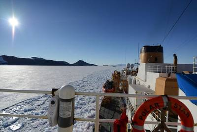 U.S. Coast Guard Cutter Polar Star, a heavy icebreaker homeported in Seattle, Washington, rests in the ice as the motor vessel Ocean Giant departs from the National Science Foundation's McMurdo Station, Feb. 1, 2017. One of the primary responsibilities of the Polar Star's crew is to provide an escort for the Ocean Giant through the frozen Ross Sea off of Antarctica. (U.S. Coast Guard photo by Chief Petty Officer David Mosley)