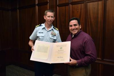 Commander Jason Smith, USCG presents the United States Coast Guard Meritorious Public Service Award to Roy Bleiberg, Vice President of Engineering for ABS Americas Division. Photo ABS