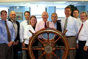 L-R, Art Mead of Crowley. John Ara of  Crowley, Eric McAllister of McAllister, Margaret Kaigh Doyle of MRA, Brian McAllister of  McAllister, David Usher of MPC, Dan Schwall of Titan, Buckley McAllister of McAllister, and Scott Powell of MHR. (Photo courtesy MRA)
