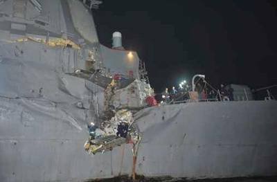 Damaged USS Essex:Photo credit USN
