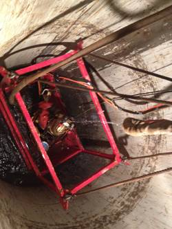 Divers, working in a man basket, were lowered into 7 foot diameter casing to the various depths of work, from 120 feet to 170 feet.