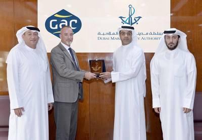 "Amer Ali, Executive Director of DMCA, and his team receiving Mr. Simon Duran, the Director General of ""GAC EnvironHull Limited"" at the DMCA HQ in Dubai. (photo: DMCA)"