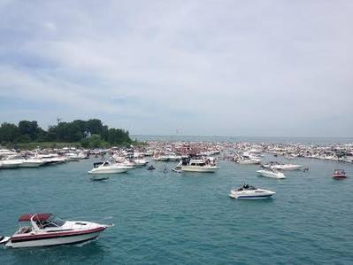 A flotilla of recreational boaters take part in an unsanctioned marine event on Lake Erie during the 2014 Operation Dry Water three-day weekend. The U.S. Coast Guard partners with other maritime law enforcement agencies during this annual campaign to reduce the number of alcohol- and drug-related accidents and fatalities while fostering a visible on-water deterrent. (USCG photo by Capt. Scott Anderson)