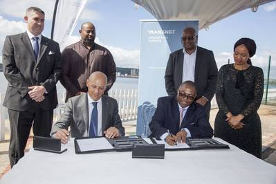 Front: Gianluca Suprani (left, of KwaZulu Cruise Terminal) and Siyabonga Gama (right, Transnet Group Chief Executive) seal the deal on the Terminal Operator agreement for Durban's new cruise terminal, flanked by (back, left to right) Ross Volk, Nkululeko Mchunu, Moshe Motlohi (Acting COO of Transnet National Ports Authority) and Shulami Qalinge (Chief Executive of Transnet National Ports Authority).