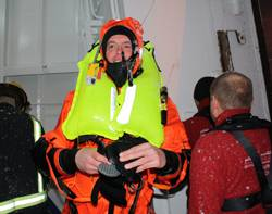 Gudmunder Bragason of Sónar emerges from Rejkavik harbour covered in ice after the successful Kru lifejacket/ R10 demonstration.