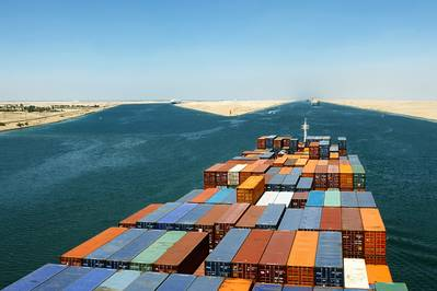 File Image: a boxship transits the suez Canal in better weather (CREDIT: © Andriy Kovach / AdobeStock)