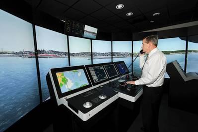 Capt. John Kessler, maritime instructor, demonstrates how mariners train using the bridge simulators at the San Jacinto College maritime program. Photo credit: Jeannie Peng-Armao, San Jacinto College